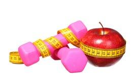 Sport equipment. dumbbells, measuring tape, apple Stock Photo