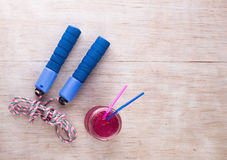 Sport equipment on floor. Top view of sport equipment set and energy drink on wooden floor Royalty Free Stock Photography
