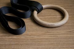Sport equipment on the floor- gymnastic rings. Sport equipment on the floor- wooden gymnastic rings Royalty Free Stock Images