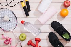 Sport equipment and footwear on wooden background.  stock images