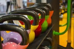Sport equipment in gym. weight kettlebell stand row on horizontal rack  at sports store Stock Photography