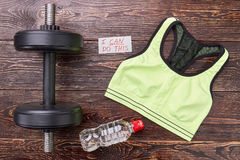 Sport equipment for muscle building. Women sporty lifestyle. Personal clothing for sport exercises Royalty Free Stock Photo