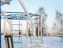 Sport In Winter. Sport equipment in a park, daytime frosty scene royalty free stock image