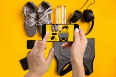 Sport equipment photographing on mobile phone. Smartphone screen with fitness tools image royalty free stock photo
