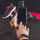 Sport equipment photographing on mobile phone. Smartphone screen with fitness tools image Stock Image