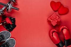 Sport equipment and red hearts. Fitness stock photos