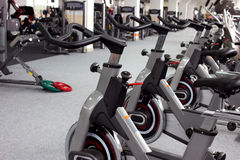 Sport equipment. Simulator's and other sport equipment  in gymnasium Stock Images