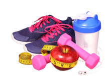 Sport equipment. Sneakers, dumbbells, measuring tape Royalty Free Stock Photo