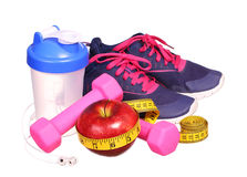 Sport equipment. Sneakers, dumbbells, measuring tape Stock Photography