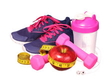 Sport equipment. Sneakers, dumbbells, measuring tape Royalty Free Stock Photos