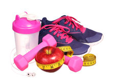 Sport equipment. Sneakers, dumbbells, measuring tape Stock Photos
