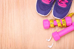Sport equipment. Sneakers, dumbbells, measuring tape Royalty Free Stock Images