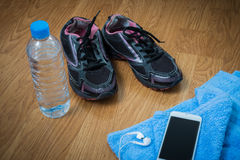 Sport equipment. Sneakers, water , earphones, smart phone Stock Image
