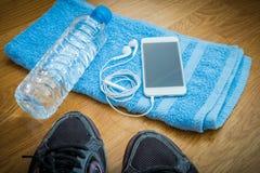 Sport equipment. Sneakers, water , earphones, smart phone Royalty Free Stock Image