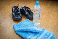Sport equipment. Sneakers, water, towel Stock Images