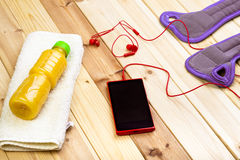 Sport Equipment. Wrist Weights, Juice, Phone. Royalty Free Stock Image