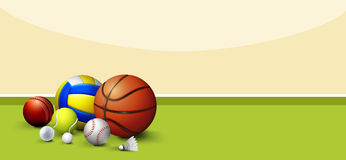 Sport equipments on green floor Royalty Free Stock Images