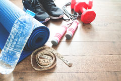 Sport equipments on wood floor, Working out Stock Photo