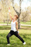 Sport exercises in the park Royalty Free Stock Photos