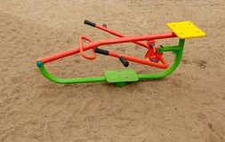 Sport exercize machines for children in a playground. Sport exercize machines for children in a sand playground stock photos