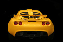 Sport expensive car. Yellow sport expensive car isolated on black background Royalty Free Stock Photography