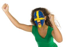 Sport fan. Young screaming Swedish fan with hands up and painted flag on faces. She's on white background Royalty Free Stock Images