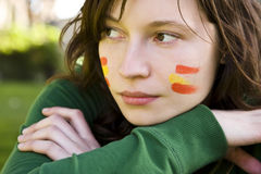 Sport fan. Sport Spanish fan with her colors in the face Stock Photos