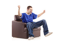 A sport fan sited in a chair Royalty Free Stock Photo