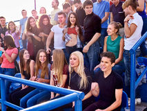 Sport fans beautiful girl asnd men on tribunes Stock Image