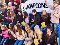 Sport fans holding champion banner on tribunes. Winter weather. Stock Images
