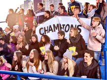 Sport fans holding champion banner on tribunes Royalty Free Stock Photo