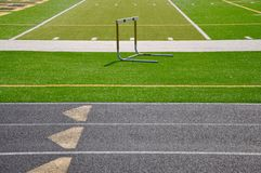 Sport field. An artificial grass sport field with track lanes and a hurdle scene that can work as a background Stock Image