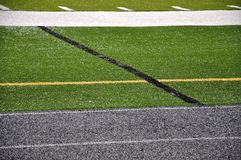 Sport field and running lanes. An artificial grass sport field with track lanes scene that can work as a background Royalty Free Stock Images