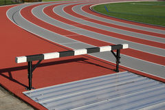 Sport field. Track and athlete hurdling field Stock Image