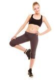 sport fille blonde sportive de forme physique étirant la jambe d'isolement Images stock