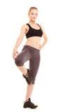 sport fille blonde sportive de forme physique étirant la jambe d'isolement Photo libre de droits