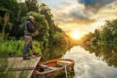 Sport fisherman hunting fish. Outdoor fishing in river Royalty Free Stock Images