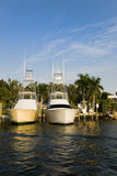 Sport fishermen at dock. Two sport fishermen pleasure boats rest at the dock in this tropical setting Royalty Free Stock Photography