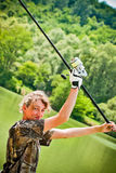Sport fishing. Female contestant is preparing to throw bait far away from the coast Royalty Free Stock Photos