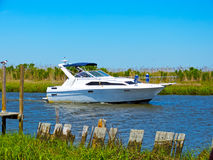 Sport Fishing Boat. A white sport fishing boat, heads towards the open sea Stock Photo