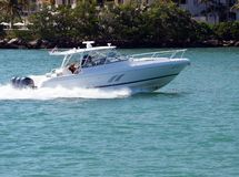 Sport Fishing Boat Headed to Port of Miami. A sport fishing boat speeding through Government Cut headed back to the Port of Miami stock photography
