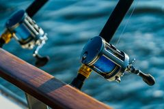 Sport fishing gear on a fishing charter. Charter fishing professional rod and reel on a boat on the ocean or bay royalty free stock photo