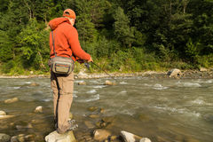 Sport fishing for trout in a mountain river Stock Photo