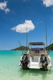 Sport fishing vacation boat on blue Laguna Royalty Free Stock Images