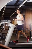 Sport, fitness, bodybuilding, lifestyle and people concept - young man doing sit-up abdominal exercises Bench Press in Royalty Free Stock Photo