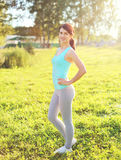 Sport, fitness concept - beautiful smiling woman preparing run royalty free stock images