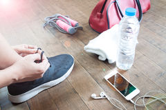 Sport fitness concept with female and sport equipments Stock Photography