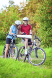 Sport and Fitness Concept. Happy caucasian Couple of Cyclists Wi Stock Image