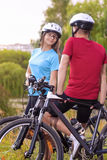 Sport and Fitness Concept: Two caucasian Cycling Athletes Restin Royalty Free Stock Photography