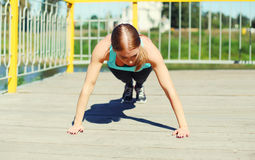 Sport, fitness concept - woman doing push-ups exercise Stock Photo